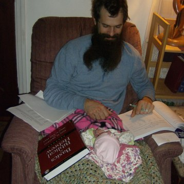 Daddy studying with New Baby Boy